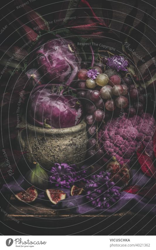 Still life with purple fruits and vegetables. Dark still life dark rustic ingredient nutrition vegetarian natural diet raw organic background fresh healthy food