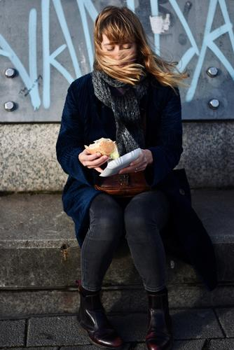 ..first a fish sandwich, if the wind allows! Woman Young woman 25-29 years Blonde long hair Winter Scarf Fish roll Wind windy Blown away Adults naturally pretty