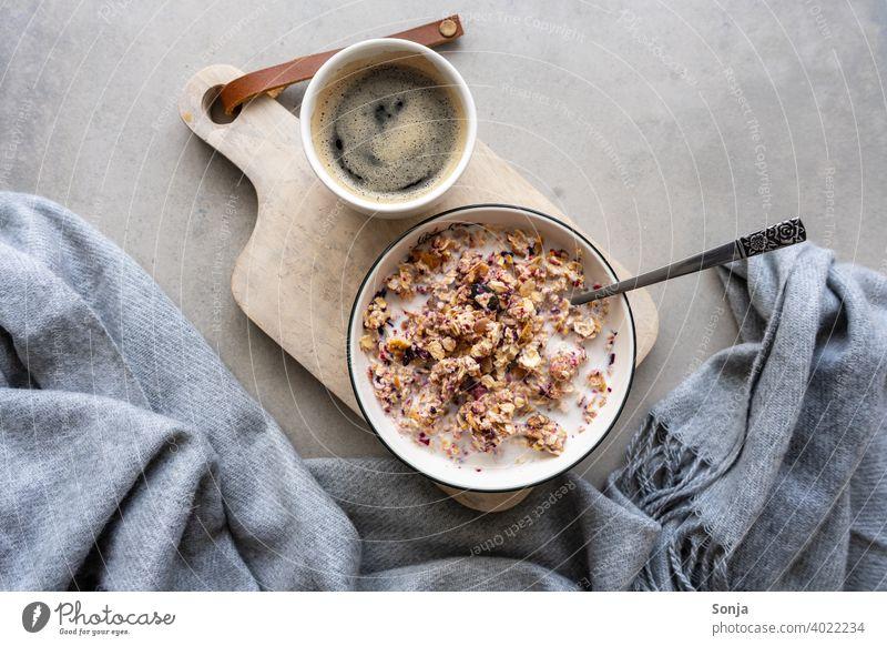 Muesli with milk in a bowl and a cup of coffee. Healthy breakfast. Cereal Milk Bowl Breakfast Coffee Chopping board Wood porridge Healthy Eating Rustic Vitamin