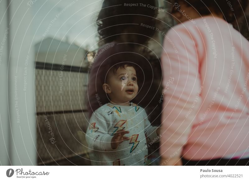 Toddler looking at sister through the window Brothers and sisters Family & Relations family Together togetherness Joy Love Boy (child) Friendship 2 Colour photo