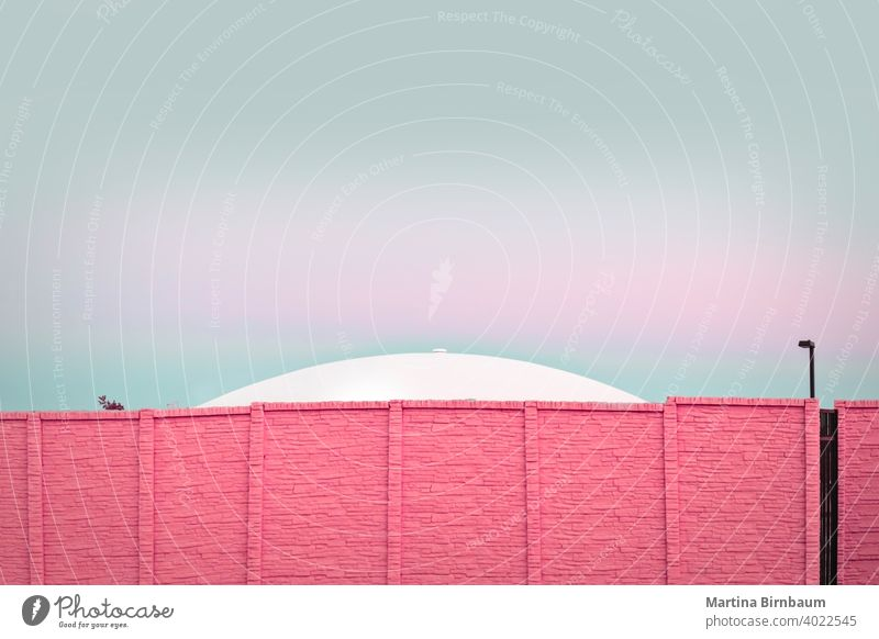 Modern architecture, UFO behind a pink brick wall modern pastel colors outdoors ufo background texture copy space urban material stone abstract surface
