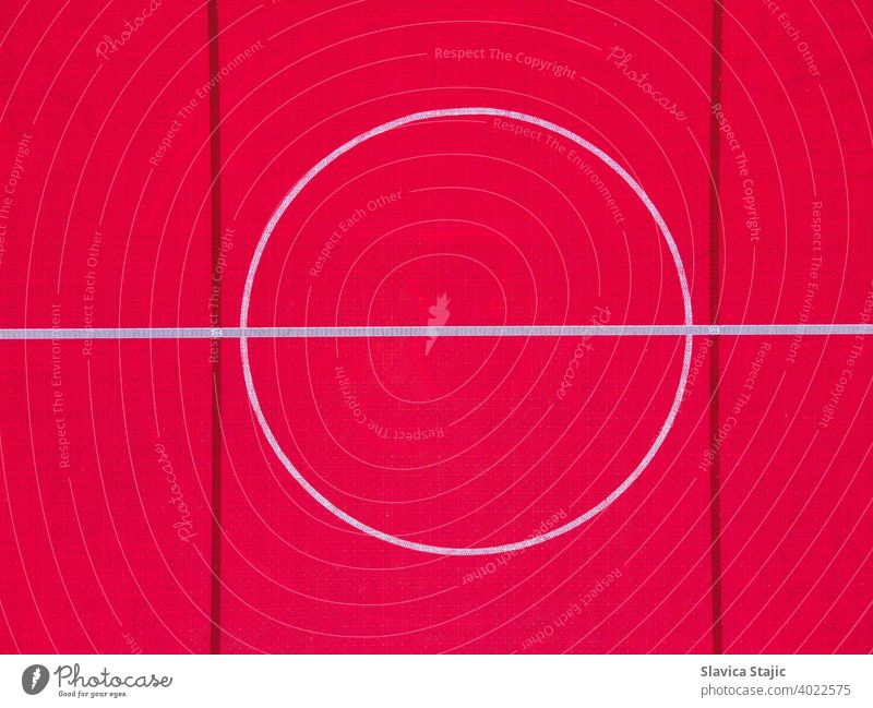 Plastic outdoor basketball court  floor, detail. Outdoor sport ground with red surface for playing basketball  in urban area, above. abstract activity backdrop