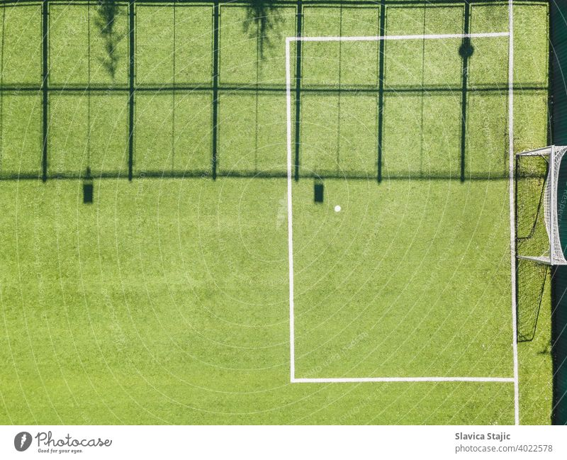Green Urban Soccer Court. Outdoor sport ground with green surface for playing football  or soccer  in urban area, detail, drone view activity artificial