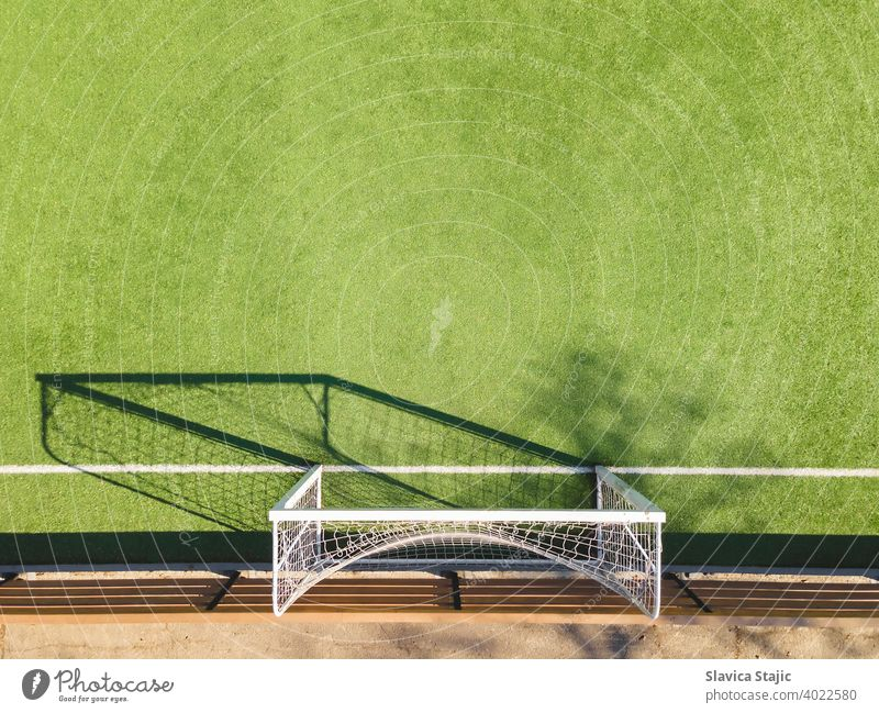 Green Soccer Court Detail .Outdoor sport ground with green surface for playing football  or soccer  in urban area, detail activity artificial backdrop