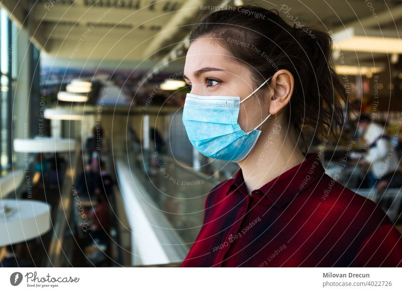 Beautiful pretty worried caucasian young woman wearing protective surgical face mask anxiety attractive buying caution contagious corona coronavirus covid-19
