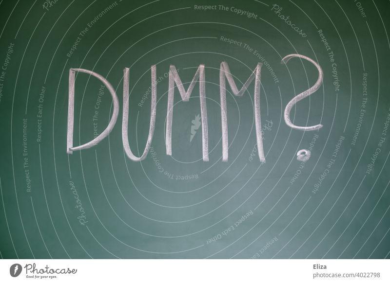 Stupid? - Question written on blackboard question uneducated Blackboard Education miss Perplexed Irritation Word authored Affront Disdvantaged witless stupid