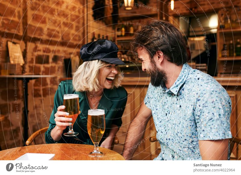 Caucasian couple having a drink at a bar. adult woman people happy female restaurant lifestyle two caucasian beautiful happiness together smile boyfriend