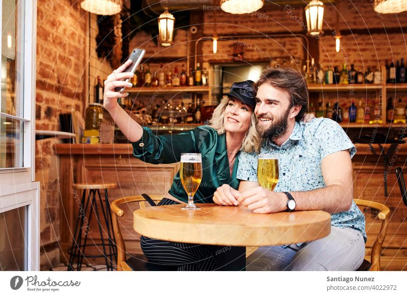 Caucasian couple having a drink at a bar. adult woman people happy female restaurant lifestyle two caucasian happiness smile boyfriend romantic indoors romance