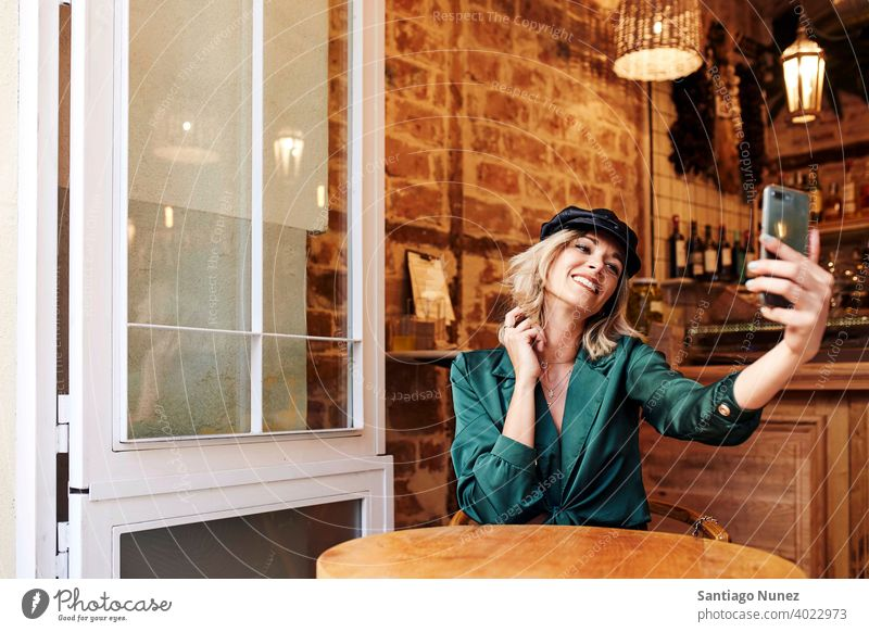 Woman taking a selfie at a bar. adult woman happy female restaurant lifestyle caucasian beautiful happiness smile fun love joy celebration dating romantic