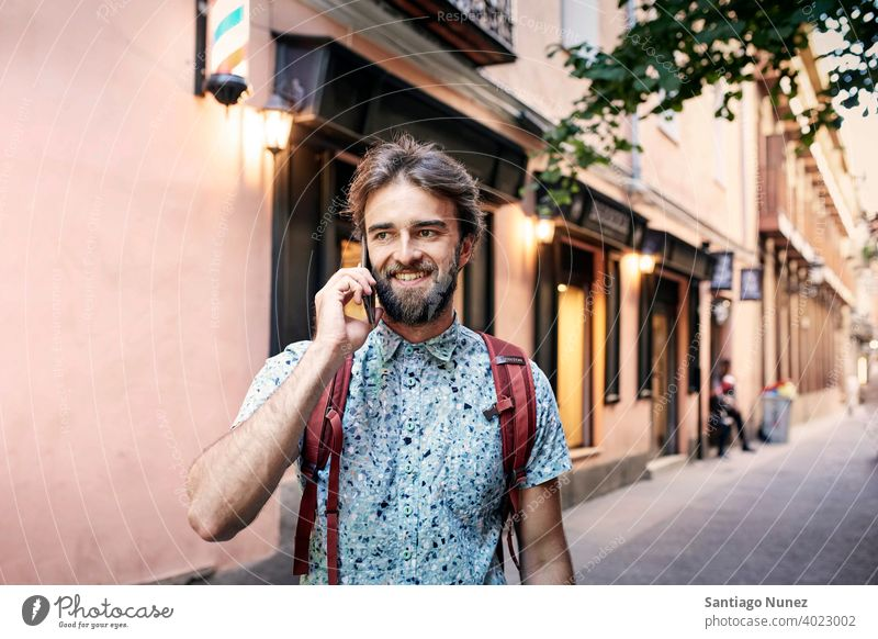 Man being on his phone on the streets. adult happy lifestyle caucasian happiness smile fun love joy leisure cheerful laughing date smiling enjoyment 30s