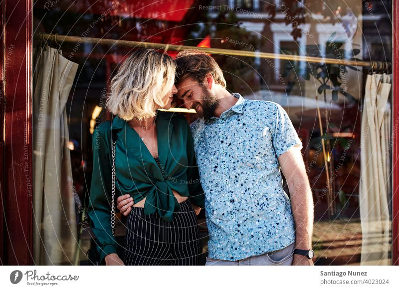 Caucasian couple on streets hugging. adult woman people happy female lifestyle two caucasian beautiful happiness together drink smile fun love joy boyfriend
