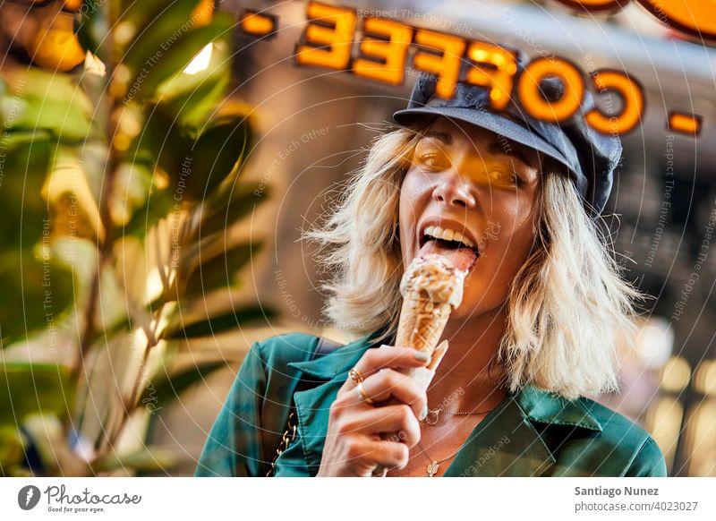 Woman licking ice cream looking through window. couple adult woman happy female lifestyle caucasian beautiful happiness smile fun love joy celebration dating