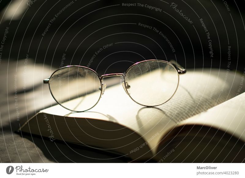 Glasses on a book. Reading a book. Knowledge. Wisdom Book Reading glasses studying Education Eyeglasses Study Literature Library Information