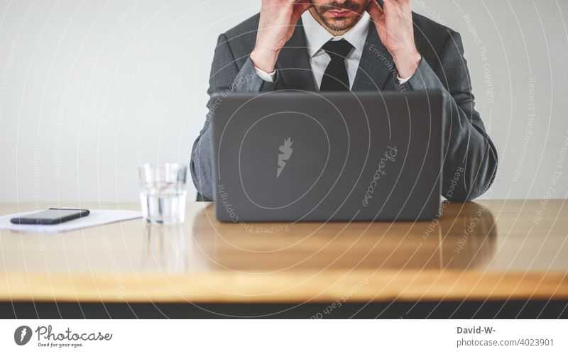 Man in suit at laptop Workplace Notebook overloaded strained Headache concentrated Desk Business businessman home office Concentrate labour job Suit Office