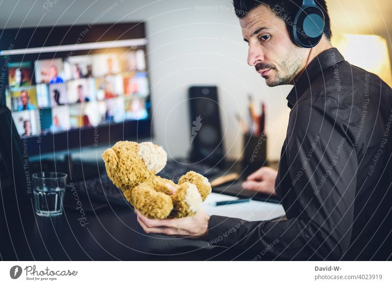 Man in home office - raising children and work laptop Parenting labour Notebook Conscience Single parent meeting Online coronavirus pandemic Business Family