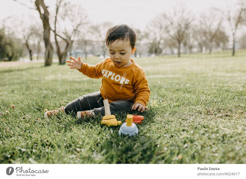Toddler playing with woodem toys at park Spring outdoors Park Playing Kindergarten Exterior shot Child Infancy Joy Colour photo Playground Human being Day Happy
