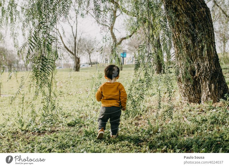 Child playing in the park Tree childhood 1 - 3 years Authentic Caucasian Colour photo explore Day Infancy Lifestyle Happiness Multicoloured Joy Happy