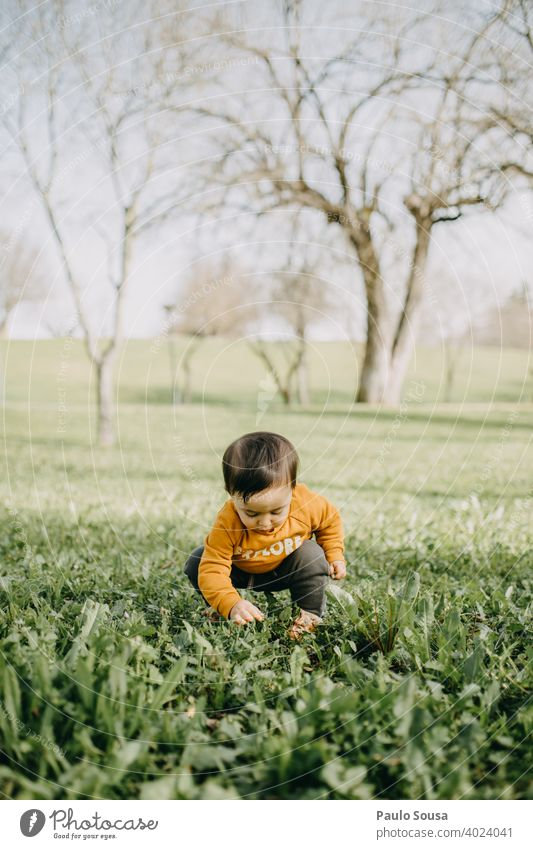 Child playing in the park Park Caucasian 1 - 3 years Colour photo Infancy Human being Toddler Day Exterior shot Lifestyle Joy Cute Grass Spring Authentic