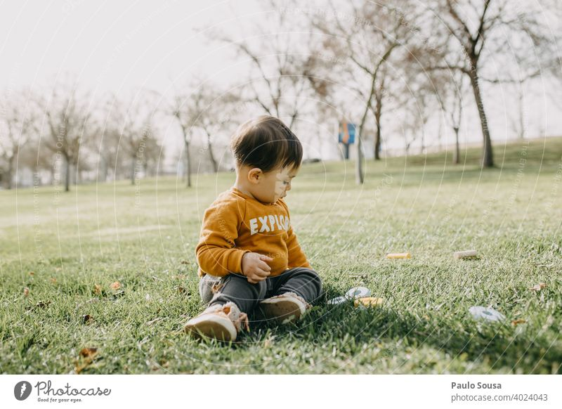 Child playing in the park childhood Caucasian Happy Childhood memory Happiness Authentic Joy Lifestyle Colour photo Infancy 1 - 3 years Playing