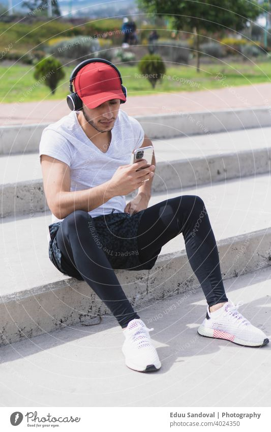 Young man listening to music for exercise. physical exercise sport smile young caucasian training female fitness smiling woman healthy athlete earphones happy