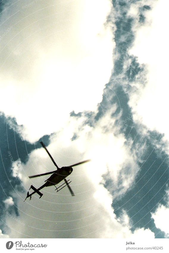 helicopters Aviation Sky Clouds Helicopter Aircraft Movement Colour photo Deserted Copy Space top Contrast Back-light
