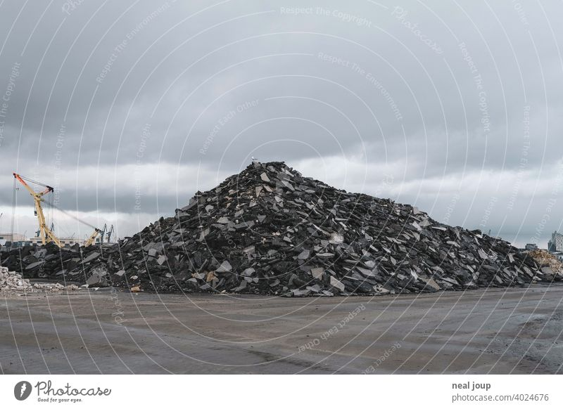 Pile of rubble on an industrial wasteland, which a single seagull uses as a vantage point Industry Fallow land Harbour Dockside crane Hill Heap Gravel stones