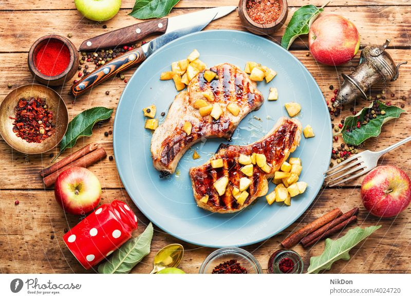 Meat baked with apples steak meat fried roasted barbecue entrecote pork caramelized rib apple sauce grilled autumn food delicious grilled meat bbq table