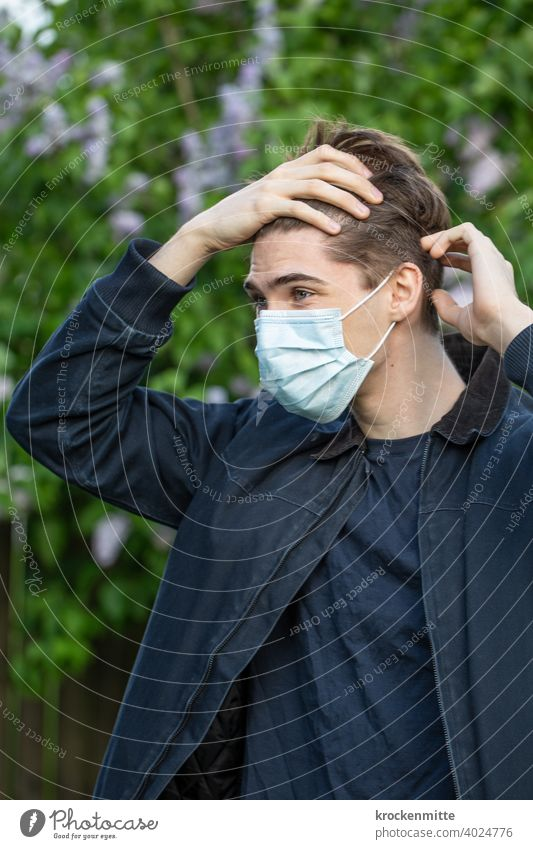 Teen in protective mask grabs her forehead teenager younger Outdoors Summer youthful coronavirus covid-19 COVID Corona virus Virus Healthy Risk of infection