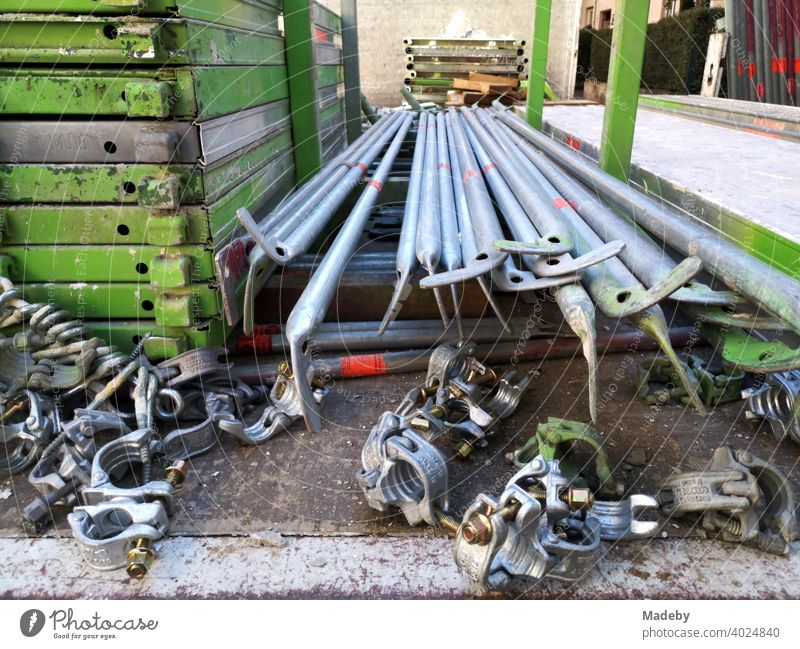 Iron rods and connecting parts of a scaffolding on the loading area of a truck at a construction site in Frankfurt am Main Bockenheim in Hesse, Germany Scaffold