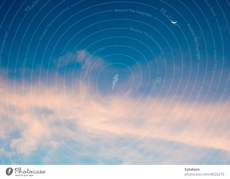 Crescent moon and clouds in the sky crescent fluffy blue pink purple white background day light nature outdoor space sunlight vibrant weather air bright