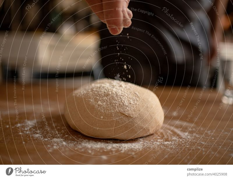 A dough is kneaded on a kitchen table and dusted with flour Dough pizza dough Kitchen Kitchen Table Flour Self-made Baking Bakery Baked goods Bread bread dough