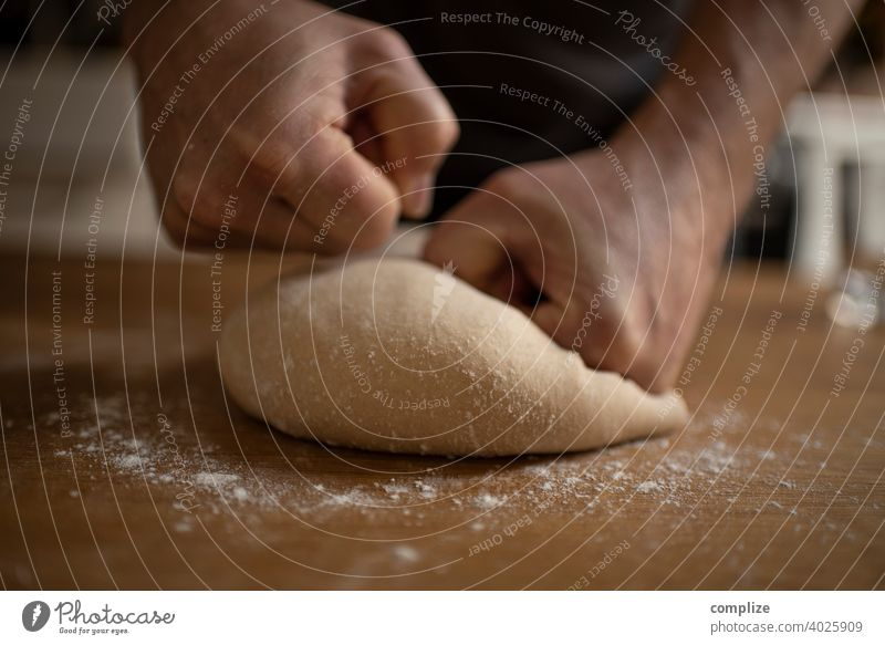A dough is kneaded on a kitchen table Dough pizza dough Kitchen Kitchen Table Flour dust Self-made Baking Bakery Baked goods Bread bread dough hands Fist Child