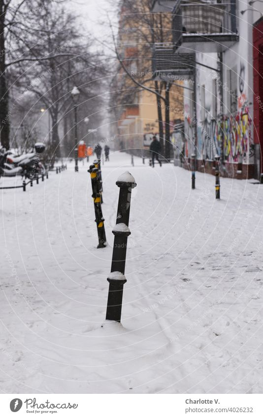 Berlin in Winter Snow Bollard Town Graffiti snowy street photography steep Street Scene Cold winter White chill Snowscape Snow layer Exterior shot Winter mood
