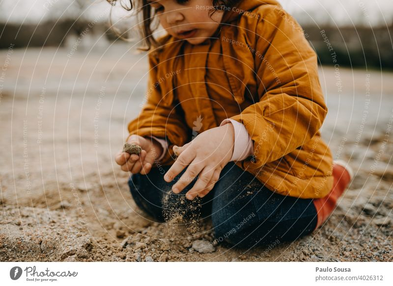 Child playing with rocks and sand Winter Autumn Authentic Playing 1 - 3 years Human being Toddler Happiness Day Nature Colour photo Joy Exterior shot Infancy