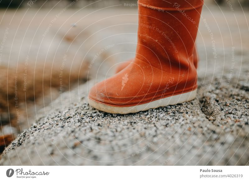 Child red rubber boots Red Rubber Rubber boots Feet shoes Boots Rain Exterior shot Wet Footwear Weather Water Dirty Human being Joy Legs Copy Space Colour photo