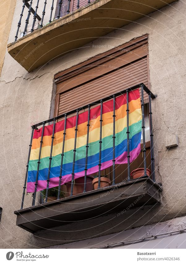 LGBT rainbow flag on a balcony on the front of a house somewhere in an old town in southern Europe Rainbow Rainbow flag gay lesbian Homosexual Love Freedom