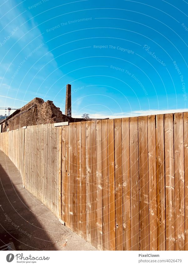 Construction fence in front of an industrial site Fence Wood Wooden board Wall (building) Deserted Wooden wall Brown, Facade Structures and shapes Colour photo