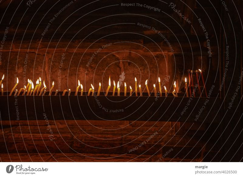 Lots of lit candles in a church! Candlelight Candle flame shoulder stand Deserted Flame Light Candlewick Illuminate Dark Fire Wax Bright Romance Burn Warmth