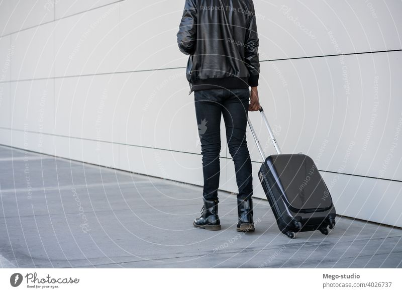 Tourist man carrying suitcase while walking outdoors. travelling tourist traveler destination concept holiday joy enjoy adventure traveller vacations portrait