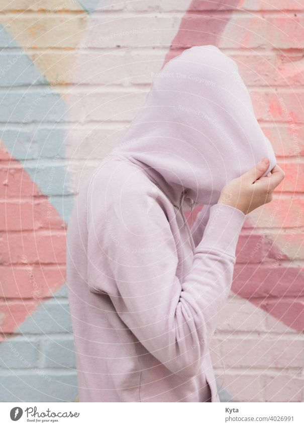 Introverted Teen Pulls their hoodie over their head introverted shy teen pastel Pastel tone pastel shades mental health mental illness depression