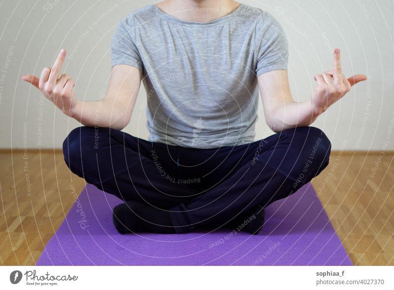 Stress management - Man sitting in cross legged position showing both middle fingers stress management meditation work life balance fuck stressed yoga burnout