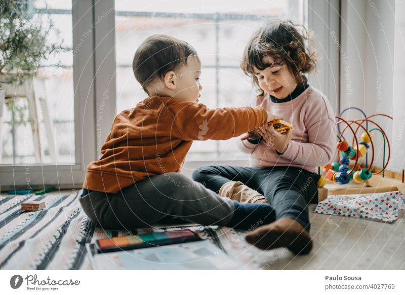 Brother and sister playing on the floor Brothers and sisters Family & Relations Child childhood Authentic Caucasian Emotions Toddler Playing Lifestyle Infancy