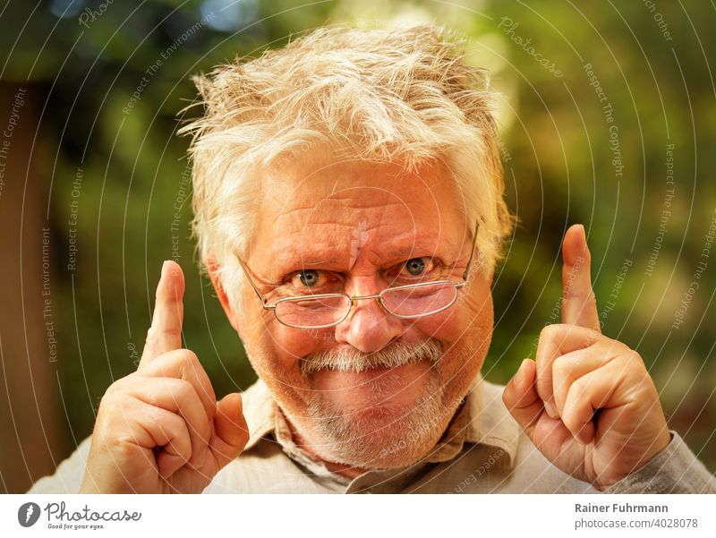 a strange man with glasses suddenly has an idea incursion Idea Awareness Inspection discovery portrait Man Eyeglasses mazy Grinning Joy Fingers Indicate out