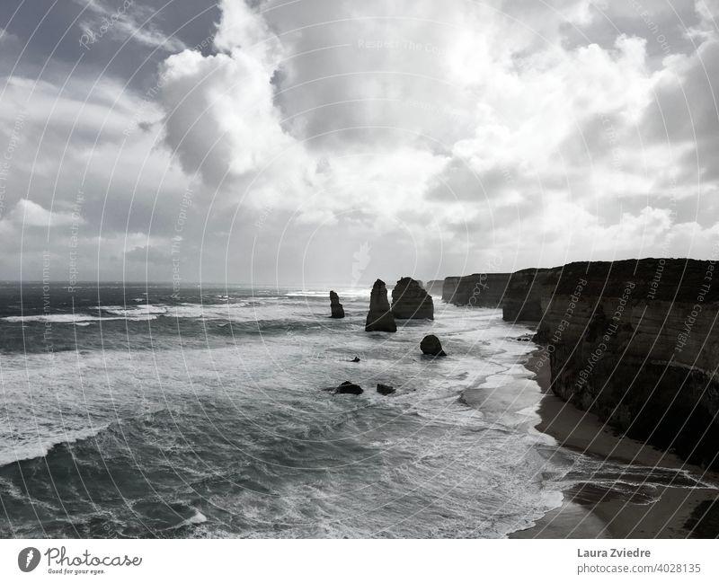 Twelve Apostles in Australia Great Ocean Road Exterior shot Waves Rock Beach Coast Water Sky Vacation & Travel Day Nature Summer Cliff Tourism Landscape