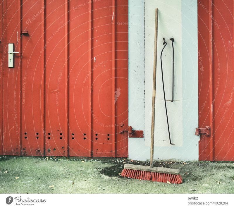return journey Broom Garage door Tin Metal Wood Red Break Closing time Calm Lean Still Life Secrecy Peaceful Colour photo Exterior shot Deserted Copy Space left