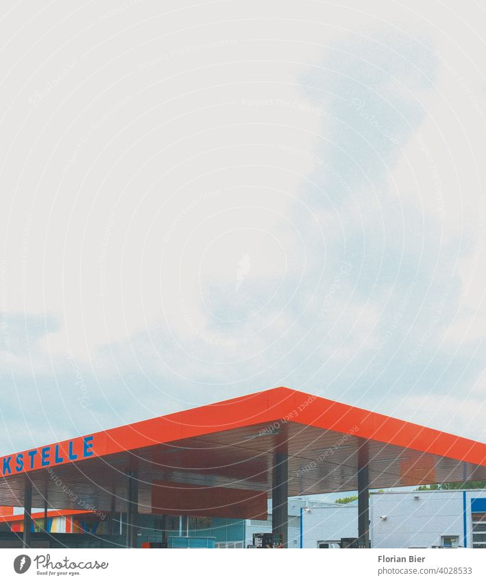 Gas station roof in signal color under cloudy sky Petrol station Roof construction Transport Esthetic Aesthetics Architecture Colour abstract photography