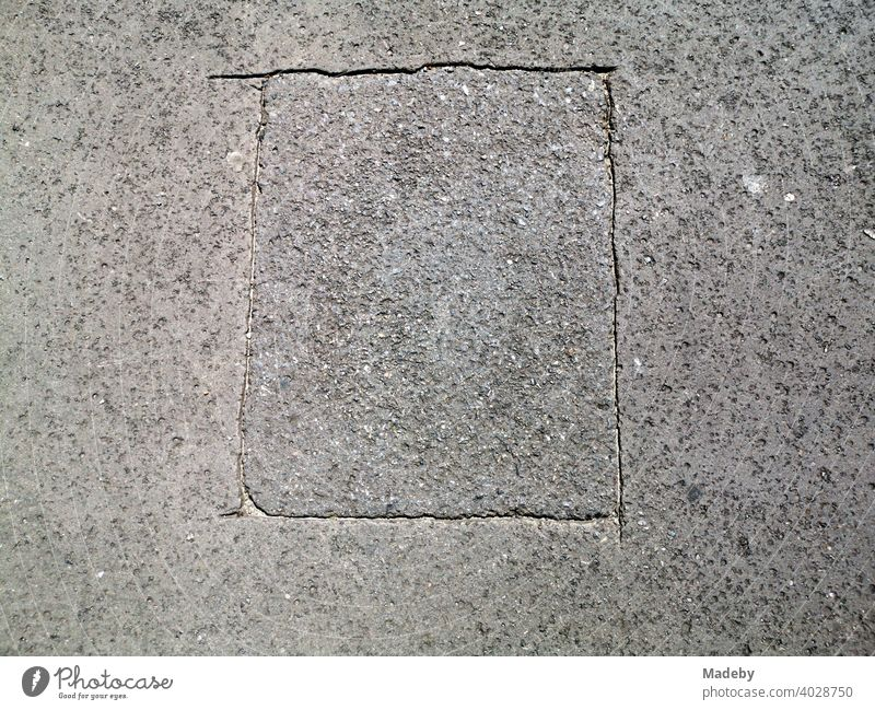 Marked rectangle in grey asphalt at the former Berlin Wall at Checkpoint Charlie in the capital Berlin, Germany Street Traffic lane Asphalt Woman road surface