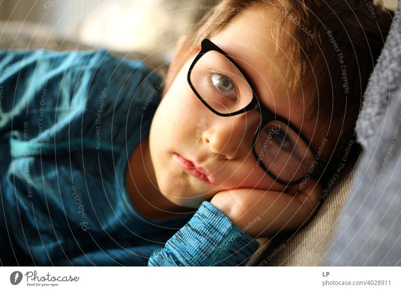 beautiful child wearing glasses looking very serious into the the camera puzzled Perplexed sceptical scepticism doubts Doubt hestitate uncertainty confusion