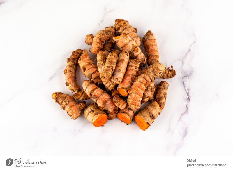 Set of various turmeric roots on a marble table. Concept of natural medicine and homeopathy spice ingredient seasoning fresh organic isolated curcuma horizontal