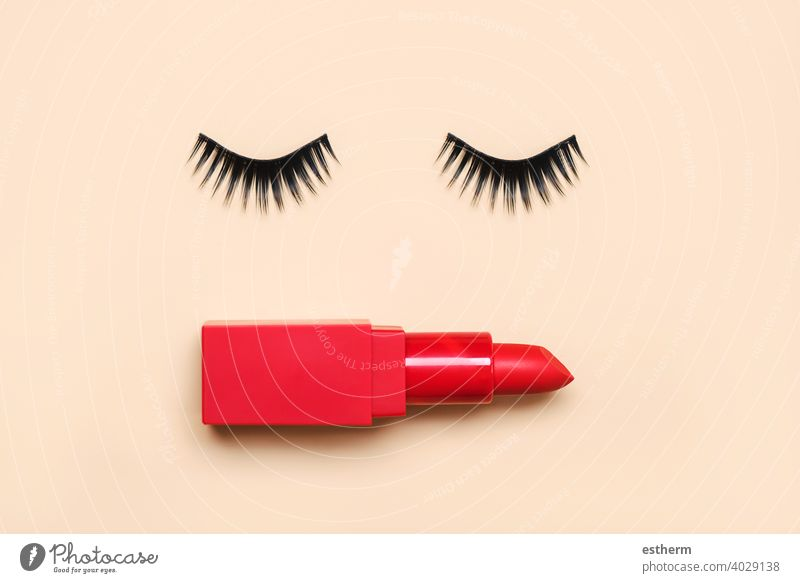 False eyelashes and red lipstick.Beauty and makeup concept false eyelashes people eyebrows brush nail object curve eyes facial pair accessory color background